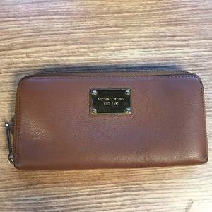 Authentic Michael Kors zip up leather wallet